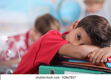 sleepy boy in classroom