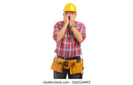 Sleepy builder rubbing eyes with hands as tiresome concept isolated on white background