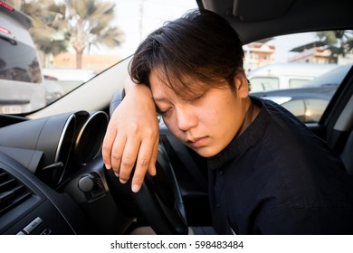 Sleepy Driver Sleeping on Steering