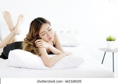 Sleepy girl, Beautiful asian woman in black sexy nightwear Sitting in bedroom, Korean woman