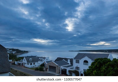 sleepy holiday homes in a coastal estate in the early morning with an overcast clouded sky