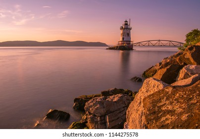 Sleepy Hollow lighthouse, in New York State's Hudson Valley, viewed at sunset, shot using slow shutter speed