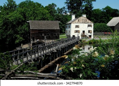 Sleepy Hollow, NY - July 9, 2009:  Mill Pond Bridge, wooden grist mill, and c. 1750 Philipse family manor house at Philipsburg Manor