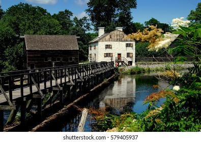 Sleepy Hollow, NY - July 9, 2009:  The beautiful setting at historic c. 1750 Philipsburg Manor with the grist mill at left and the Frederick Philipse Manor house