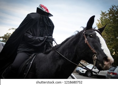 Sleepy Hollow, NY - October 28, 2018: Headless horseman rides a black horse to give a Halloween scare.