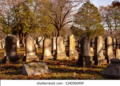 Sleepy Hollow, NY / United States - Nov 23, 2018: Tombstones at Sleepy Hollow Cemetery in Sleepy Hollow, New York, is the final resting place of numerous famous figures, including Washington Irving.