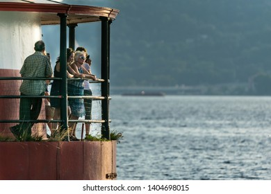 Sleepy Hollow, NY/USA - 07/27/2018: Tourists standing by the Sleepy Hollow lighthouse, enjoying the view across the Hudson River on a beauitful summer afternoon