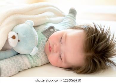 Sleepy little baby boy taking a nap