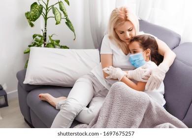 Sleepy little child with mom - shallow DOF, focus on little girl's eyes