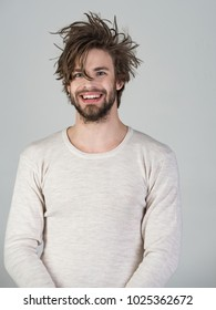 Sleepy man with beard on grey background. Morning wake up, everyday life. Insomnia, energy, single with uncombed hair. Man with disheveled hair in underwear. Barber and hairdresser, male fashion.