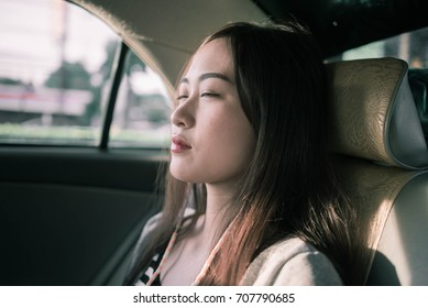 sleepy woman siting in car