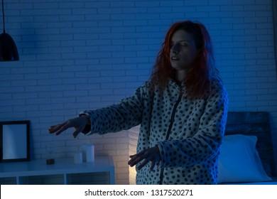 Sleepy woman with  somnambulism sleep walking at home