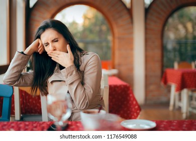 Sleepy Woman Yawning while Waiting In a Restaurant. Tired girl sitting in cafeteria on a boring date