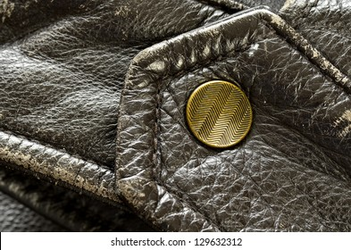 Sleeve of leather jacket with detail on the snap or button