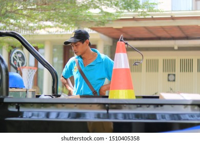 Sleman, Yogyakarta / Indonesia - August 05, 2019: Portrait some workers wearing hardhats taking break from work joking with each other in workshop