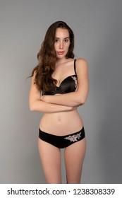 Slender tall young brunette in black lingerie