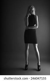 Slender woman in black tight dress