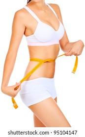 Slender woman measuring her waist. Diet, healthy lifestyle.