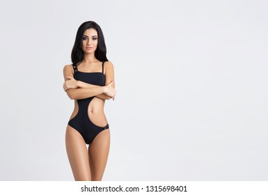 Slender and young girl with beautiful and fit body. Woman in swimsuit. Sport, diet, health and beauty concept.