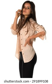 Slender young Romanian woman in a beige blouse and black leggings