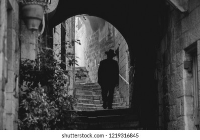 Slhouette of a jewish man in the arch of Jerusalem old city street, Israel