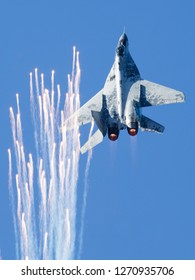 SLIAC / SLOVAKIA - AUGUST 27, 2016: Slovak Air Force MiG-29 0921 fighter jet display and dropping flares at Sliac airshow