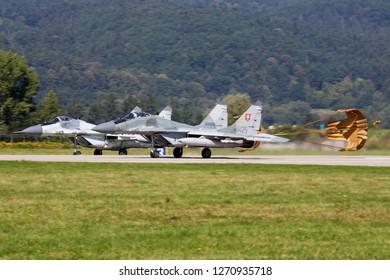 SLIAC / SLOVAKIA - AUGUST 28, 2016: Slovak Air Force MiG-29 6425 fighter jet pair landing at Sliac Air Base