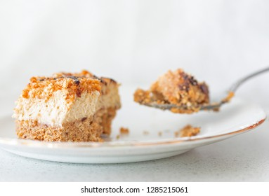A slice of Amaretti and mascarpone cream pie and a spoon with a bite.