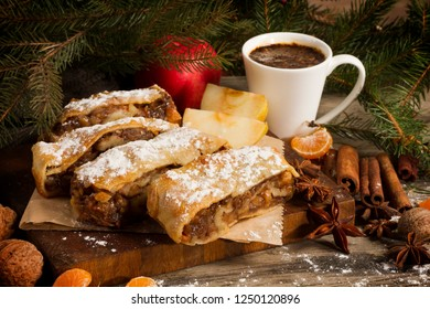 Slice of Apple strudel with apples and christmas decoration