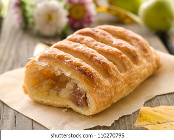 slice of an apple strudel on a baking paper