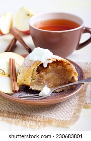 Slice of apple strudel and tea