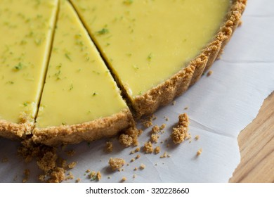 A slice of authentic Key Lime Pie with a crumbly graham cracker crust.