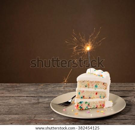 Slice Of Birthday Cake With Sparkler