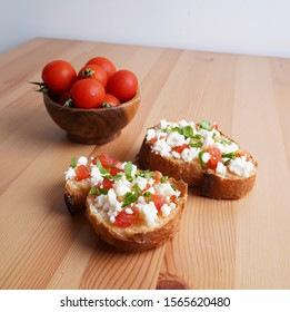 Slice of bread with cheese, tomatoes and greens