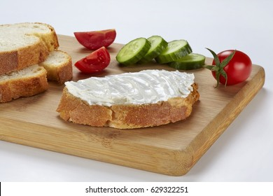 slice of bread with cream cheese (selective focus)