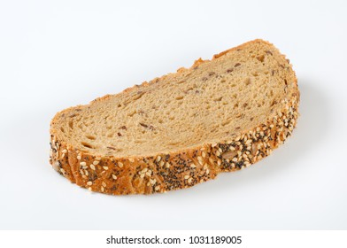 slice of bread with poppy, sunflower and sesame seeds on white background