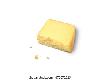 A slice of butter cake cuts in half, isolated on white background