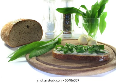 a slice of buttered bread with freshly chopped wild garlic