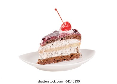 Slice of cake with cherry. Close up. Isolated on white.