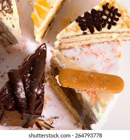 Slice of  cakes on plate ready for eating