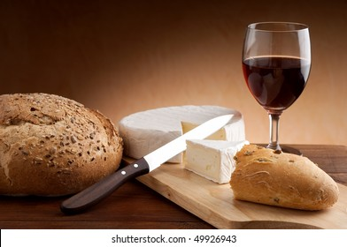 slice camembert with bread and wine