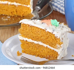 Slice of carrot layer cake on a plate