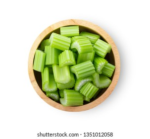 slice celery in wood  bowl isolated on white background. top view