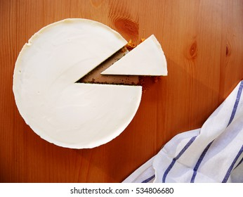 Slice cheese cake on the wooden table