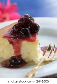 slice of cheesecake with berry topping