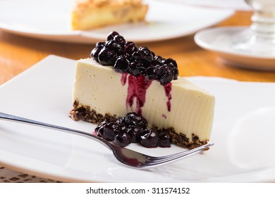 Slice of cheesecake with blueberry