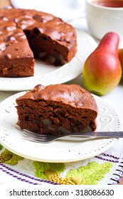 Slice of chocolate pear cake on plate
