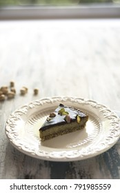 A slice of chocolate and pistachio vegan cake