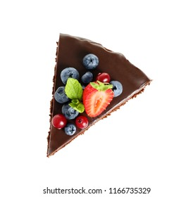Slice of chocolate sponge cake with berries on white background, top view