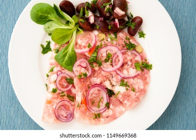 Slice of chopped pork head in aspic with runner bean salad